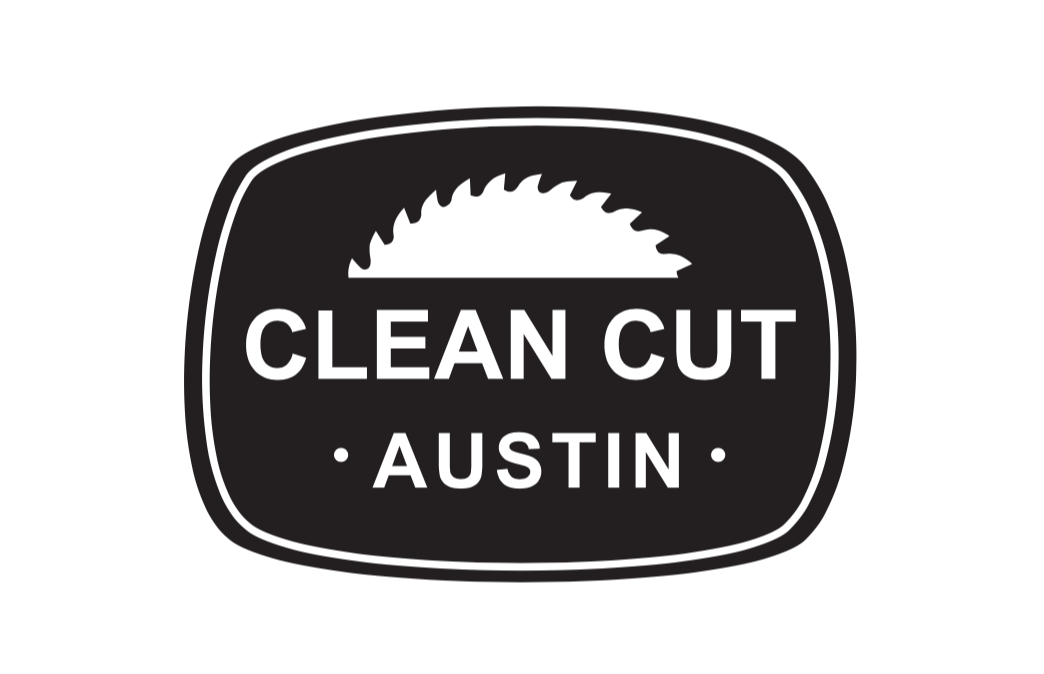 a black and white logo design with a saw blade and clean cut austin